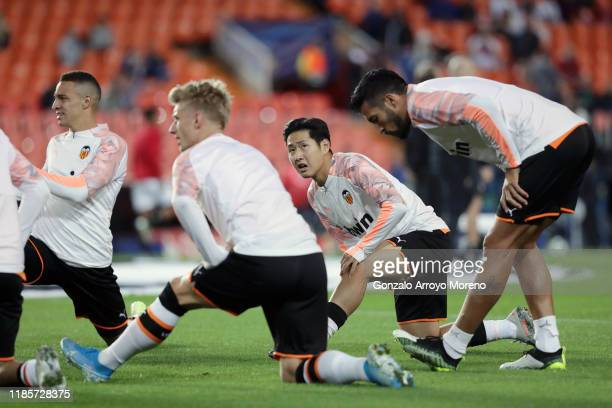 Lee Kang-In of Valencia warms up prior to the UEFA Champions League group H match between Valencia CF and Lille OSC at Estadio Mestalla on November...