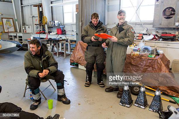 Lee Kanter moose biologist with the state of Maine at far right has a laugh as he plans a flight with members of Native Range Capture Services at the...