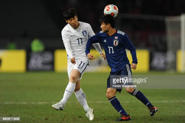 Lee Keunho of South Korea and Yasuyuki Konno of Japan compete for the ball during the EAFF E1 Men's Football Championship between Japan and South...