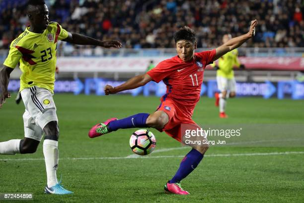 Lee KeunHo of South Korea competes for the ball with Davinson Sanchez of Colombia during the international friendly match between South Korea and...