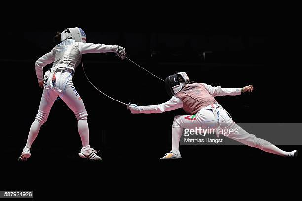 Lee Kiefer of the United States and Mona Shaito of Lebanon compete during the women's individual foil on Day 5 of the Rio 2016 Olympic Games at...