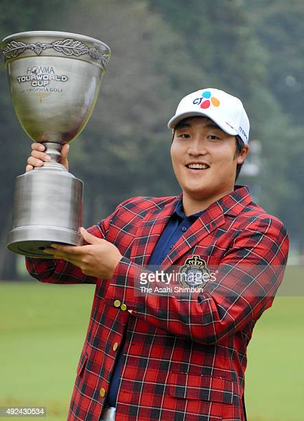 Lee KyoungHoon of South Korea celebrates with the trophy after winning the Honma Tourworld Cup at Trophia Golf at Ishioka Golf Club on October 11...