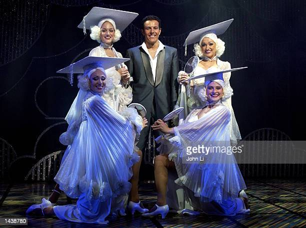 Lee Latchford Evans exSteps singer playing the part of Teen Angel stands with the Beauty School Ladies in the theatre adaptation of Grease at the...