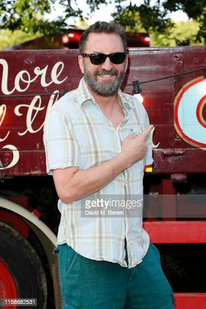 """Lee Mack attends the opening performance of """"Xanadu"""" presented by Giffords Circus at Chiswick House & Gardens on June 27, 2019 in London, England."""