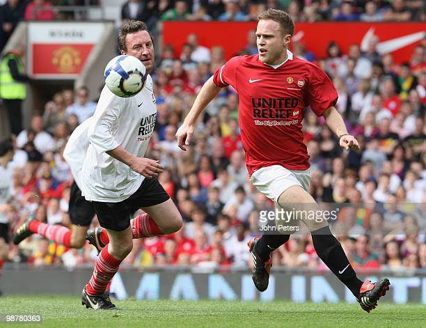 Lee Mack clashes with Olly Murs during the United Relief charity match in aid of Sport Relief and the Manchester United Foundation between Manchester...