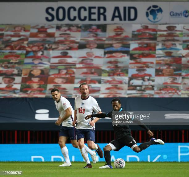 Lee Mack of England in action with Patrice Evra of Rest of the World during the Soccer Aid for Unicef 2020 match between England and Rest of the...