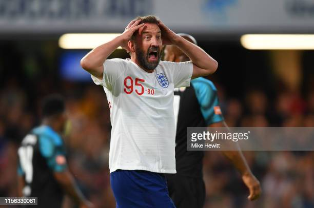 Lee Mack of England reacts after a miss during the Soccer Aid for UNICEF 2019 match between England and the Soccer Aid World XI at Stamford Bridge on...