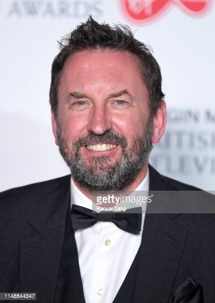Lee Mack poses in the Press Room at the Virgin TV BAFTA Television Award at The Royal Festival Hall on May 12 2019 in London England