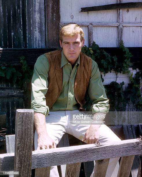 Lee Majors, US actor, wearing a tan leather waistcoat over a green shirt in a publicity portrait for the US television series, 'The Big Valley', USA,...