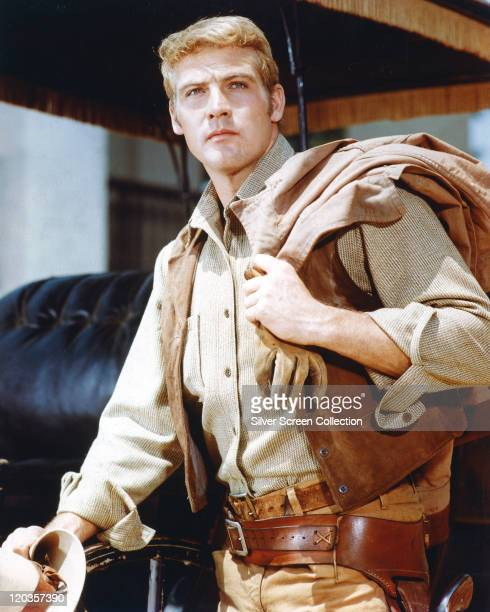 Lee Majors, US actor, wearing a tan leather wasitcoat with his jacket thrown over his shoulder in a publicity portrait for the US television series,...