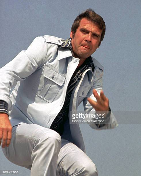 Lee Majors, US actor, wearing a white denim suit in a publicity portrait issued for the US television series, 'The Six Million Dollar Man', circa...