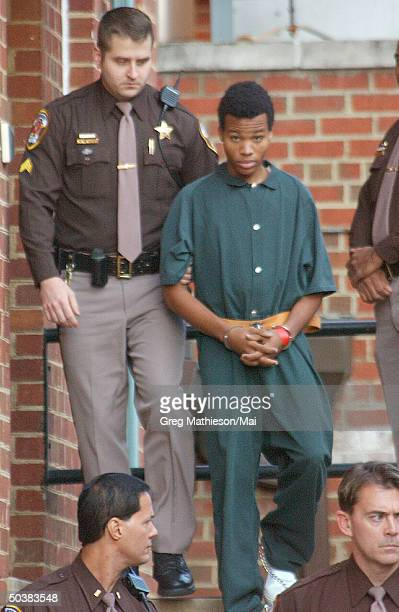 Lee Malvo, suspected accomplice of accused DC Beltway sniper John Allen Muhammad, leaving Fairfax County Juvenile Court House accompanied by armed...