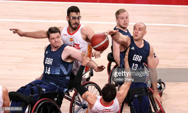 Lee Manning and Ian Sagar of Team Great Britain compete for a loose ball with Manuel Lorenzo Diaz and Daniel Stix Soto of Team Spain in the first...