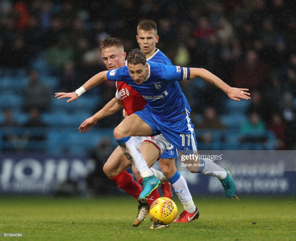 Lee Martin (11) and Jake Hessenthaler of Gillingham tussle for the ball with Kyle Dempsey of Fleetwood Town during the Sky Bet League One match between Gillingham and Fleetwood Town at Priestfield Stadium on January 27, 2018 in Gillingham, England.