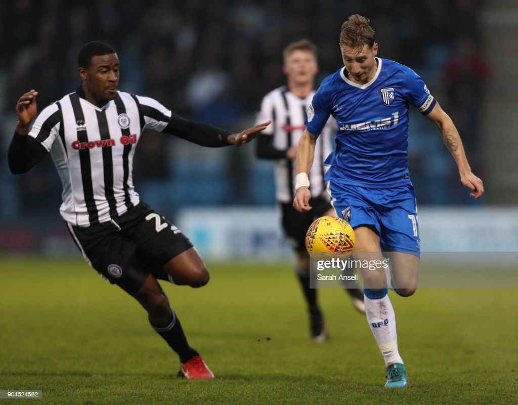 Lee Martin of Gillingham (L) is challenged by Donervon Daniels of Rochdale (R) during the Sky Bet League One match between Gillingham and Rochdale at Priestfield Stadium on January 13, 2018 in Gillingham, England. (Photo by Sarah Ansell/Getty Images).