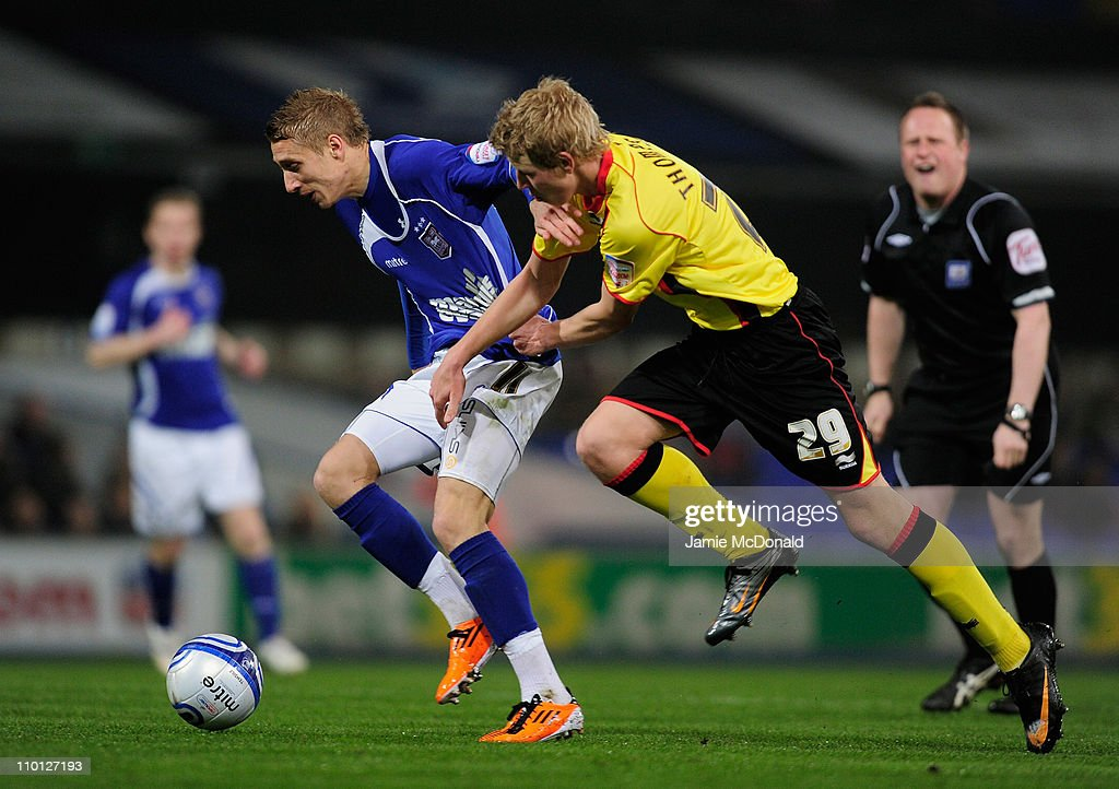Lee Martin of Ipswich Town battles with Adam Thompson of Watford during the npower Championship match between Ipswich Town and Watford at Portman Road on March 15, 2011 in Ipswich, England.