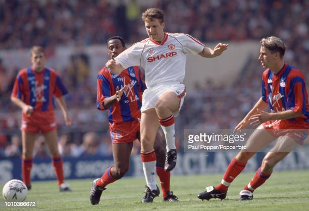 Lee Martin of Manchester United in action watched by Alan Pardew and Andy Gray of Crystal Palace during the FA Cup Final at Wembley Stadium on May 12...