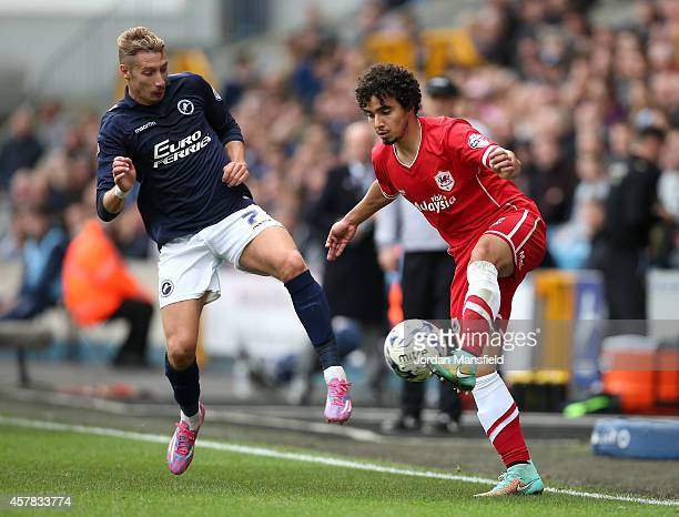 Lee Martin of Millwall comes in to challenge Fabio De Silva of Cardiff during the Sky Bet Championship match between Millwall and Cardiff City at The...