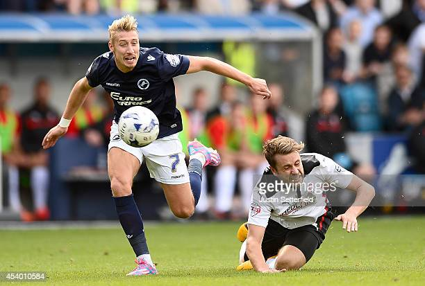 Lee Martin of Millwall FC and Lee Frecklington of Rotherham United in action during the Sky Bet Championship match between Millwall and Rotherham...