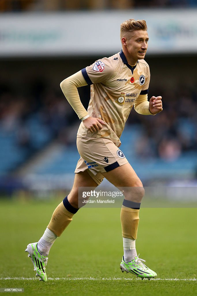 Lee Martin of Millwall plays in a special Remembrance Day commemorative camouflage kit during the Sky Bet Championship match between Millwall and Brentford at The Den on November 8, 2014 in London, England.