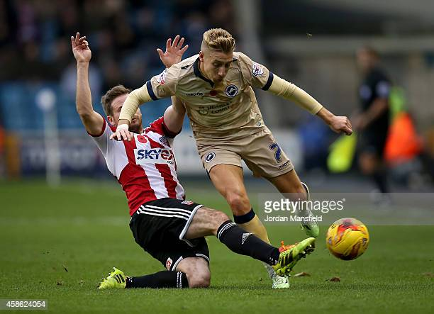 Lee Martin of Millwall tackles with Alan Judge of Brentford during the Sky Bet Championship match between Millwall and Brentford at The Den on...