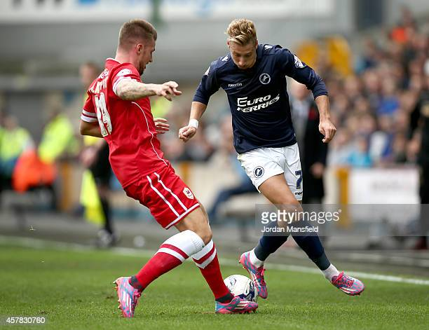 Lee Martin of Millwall takes the ball past Anthony Pilkington of Cardiff during the Sky Bet Championship match between Millwall and Cardiff City at...