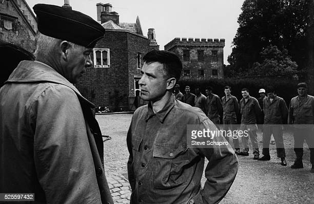 Lee Marvin, John Cassevetes, Telly Savalas and others in a scene from The Dirty Dozen