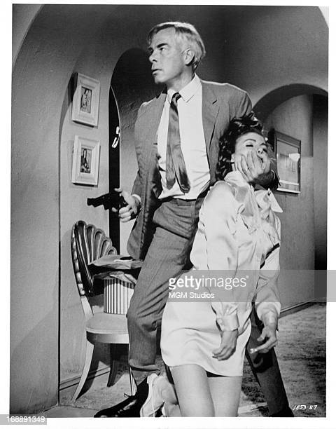 Lee Marvin restrains his wife Sharon Acker in a scene from the film 'Point Blank' 1967