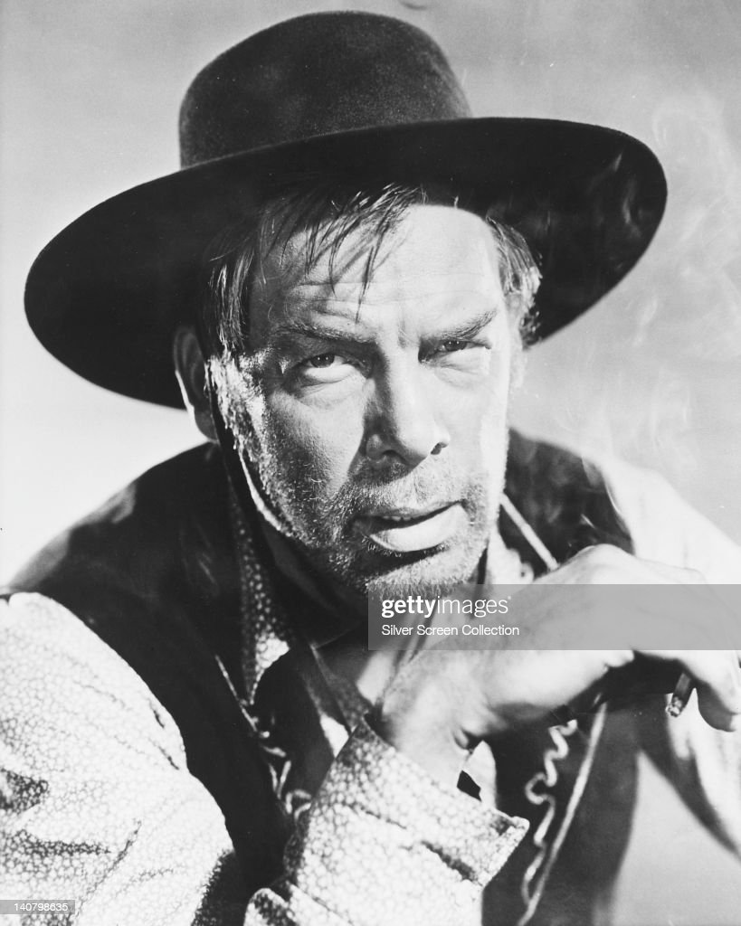 Lee Marvin (1924-1987), US actor, in costume with a black cowboy hat in a publicity portrait issued for the film, 'Cat Ballou', USA, 1965. The comedy-western, directed by Elliot Silverstein, starred Marvin as 'Kid Shelleen/Tim Strawn'.
