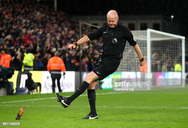 Lee Mason kicks a bottle off the pitch during the Premier League match between Crystal Palace and Watford at Selhurst Park on December 12 2017 in...