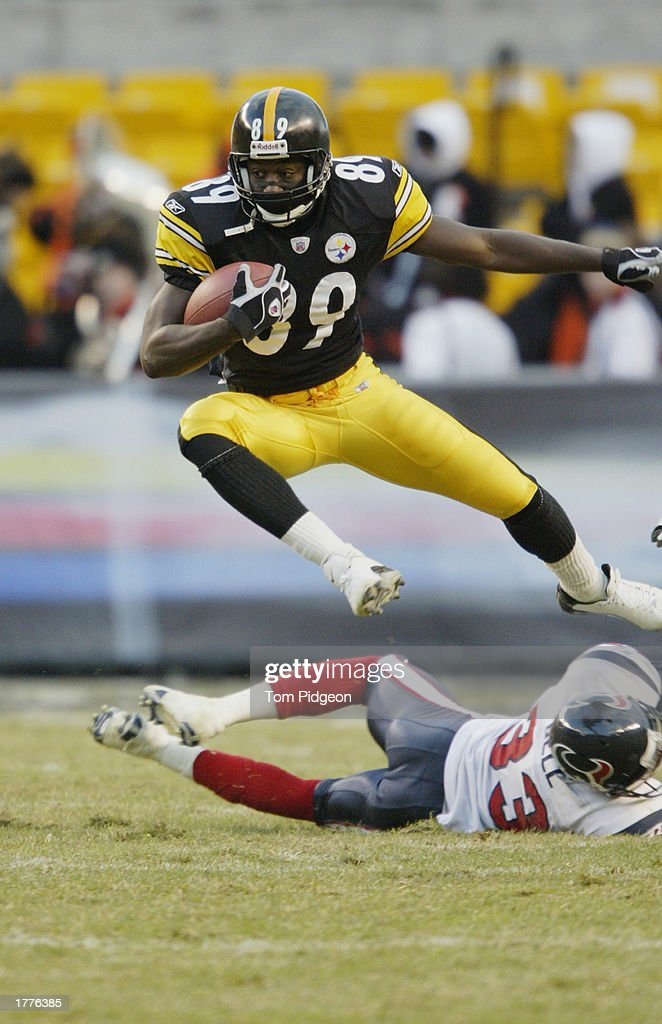 Lee Mays #89 of the Pittsburgh Steelers hurdles Jason Bell #33 of the Houston Texans on December 8, 2002 at Heinz Field in Pittsburgh, Pennsylvania. The Texans beat the Steelers 24-6.