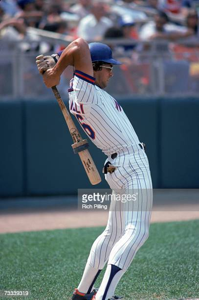 Lee Mazzilli of the New York Mets stretches as he stands on deck waiting for his at bat during a game in 1980 at Shea Stadium in Flushing, Queens,...