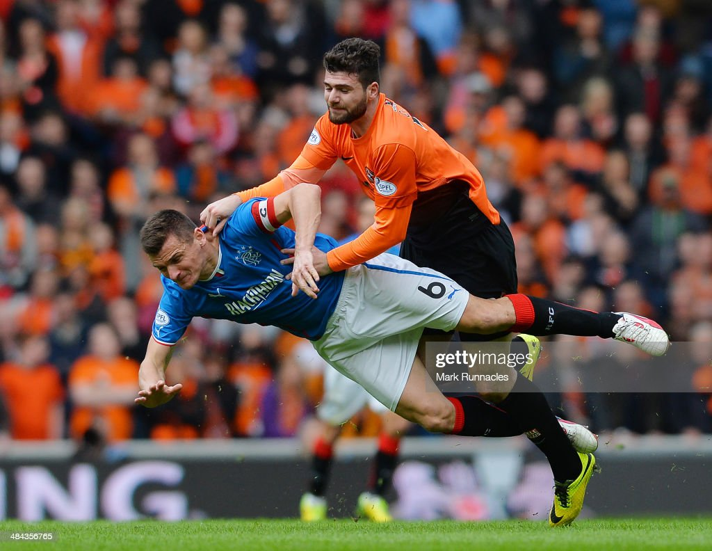 Lee McCulloch of Rangers and Nadir Ciftci of Dundee United collide during the William Hill Scottish Cup Semi Final between Rangers and Dundee United at Ibrox Stadium on April 12, 2014 in Glasgow, Scotland.