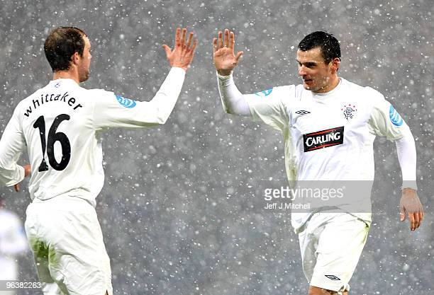 Lee McCulloch of Rangers celebrates after scoring their second goal with Steven Whittaker during the Cooperative Insurance Cup Semi Final between...
