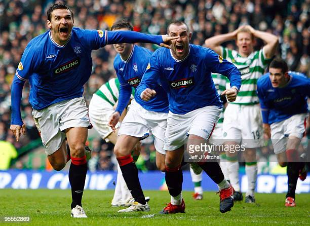 Lee McCulloch of Rangers celebrates with Kris Boyd after scoring during the Scottish Premier League match between Celtic and Rangers at Celtic Park...