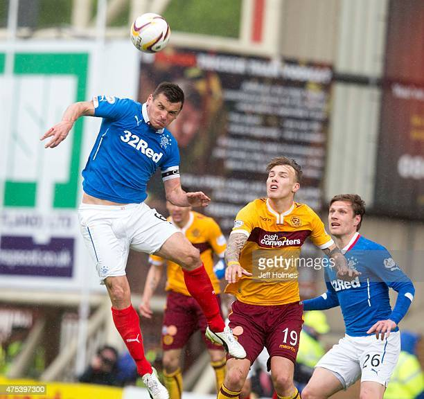 Lee McCulloch of Rangers clears the ball during the Scottish Premiership playoff final 2nd leg between Motherwell and Rangers at Fir Park on May 31...