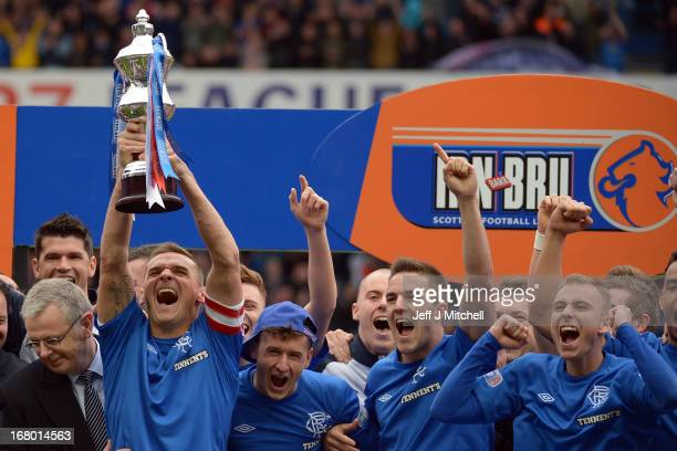Lee McCulloch of Rangers lifts the IRN - BRU Scottish Third Division trophy following their victory over Berwick Rangers at Ibrox Stadium on May 4,...