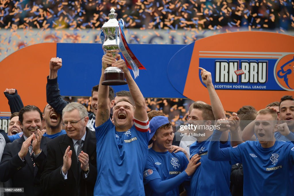 Lee McCulloch of Rangers lifts the IRN - BRU Scottish Third Division trophy following their victory over Berwick Rangers at Ibrox Stadium on May 4, 2013 in Glasgow, Scotland.