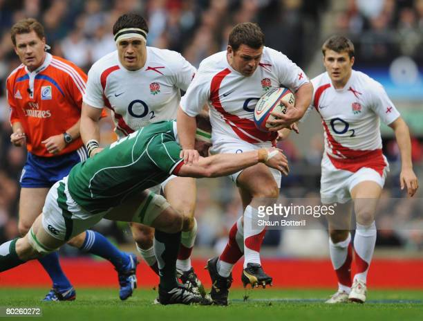Lee Mears of England is tackled by Paul O'Connell of Ireland during the RBS 6 Nations Championship match between England and Ireland at Twickenham on...