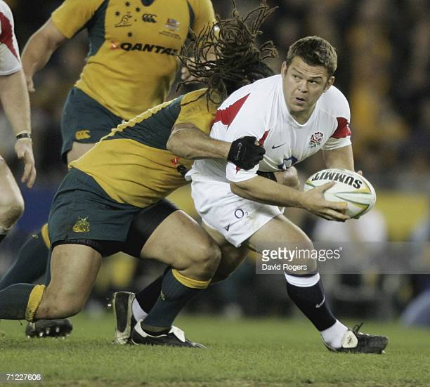 Lee Mears, the England hooker is tackled by George Smith of Australia during the second Cook Cup match between the Australian Wallabies and England...