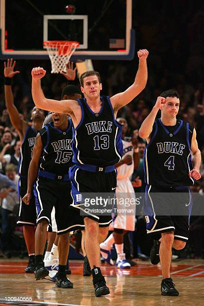Lee Melchionni and JJ Redick of the Duke University Blue Devils celebrate their victory over the Memphis University Tigers in the Championship game...