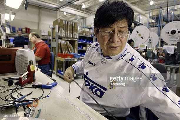 Lee Mercado measures and cuts wire leads in the preassemble area at the Danfoss Drives manufacturing plant in Rockford Illinois January 6 2004...