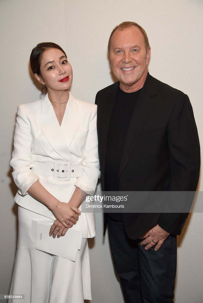 Lee Min-Jung (L) and Michael Kors attend the Michael Kors Collection Fall 2018 Runway Show at Vivian Beaumont Theatre at Lincoln Center on February 14, 2018 in New York City.