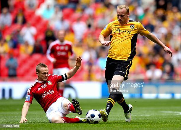 Lee Minshull of Newport is tackled by Dean Keates of Wrexham during the Blue Square Bet Premier Conference Playoff Final match between Wrexham and...