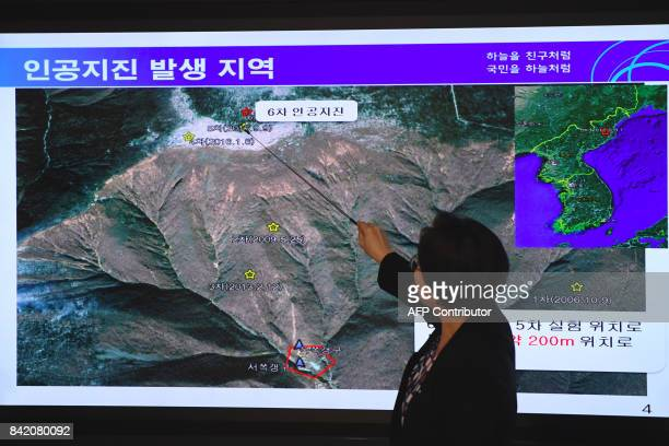 TOPSHOT Lee MiSeon a director of the National Earthquake and Volcano Center shows a map of a North Korean location during a briefing about the...