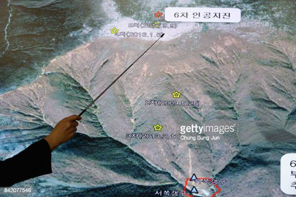 Lee MiSeon a Monotoring director of the National Earthquake and Volcano Center shows seismic waves taking place in North Korea on a screen at the...