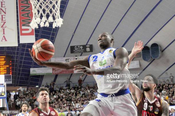 Lee Moore of Germani competes with Bruno Cerella and Austin Daye of Umana during the LBA Legabasket of Serie A match between Reyer Umana Venezia and...