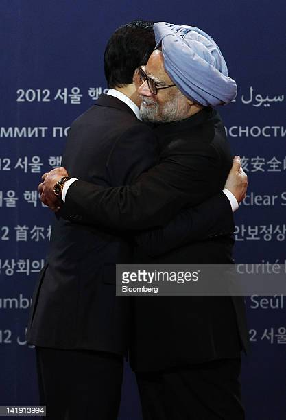 Lee Myung Bak, South Korea's president, left, embraces Manmohan Singh, India's prime minister, during a photo session before the working dinner at...