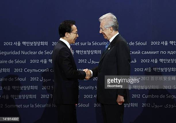 Lee Myung Bak, South Korea's president, left, shakes hands with Mario Monti, Italy's prime minister, during a photo session before the working dinner...