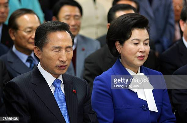 Lee MyungBak of the conservative main opposition Grand National Party and his wife Kim YoonOk await with party members for the results of the...